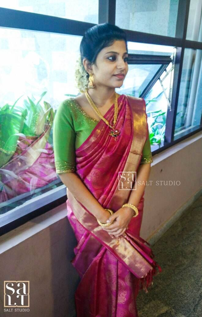 Here s a colour combination that can never go wrong - a deep pink  kancheevaramSaree teamed with a bright green embroidered blouse. Our  model  is our lovely client  Aswathy. We love her ethnic splendour!   embroidery  sarees  kanjeevaram  designer  saltstudio  kochi  happyclient