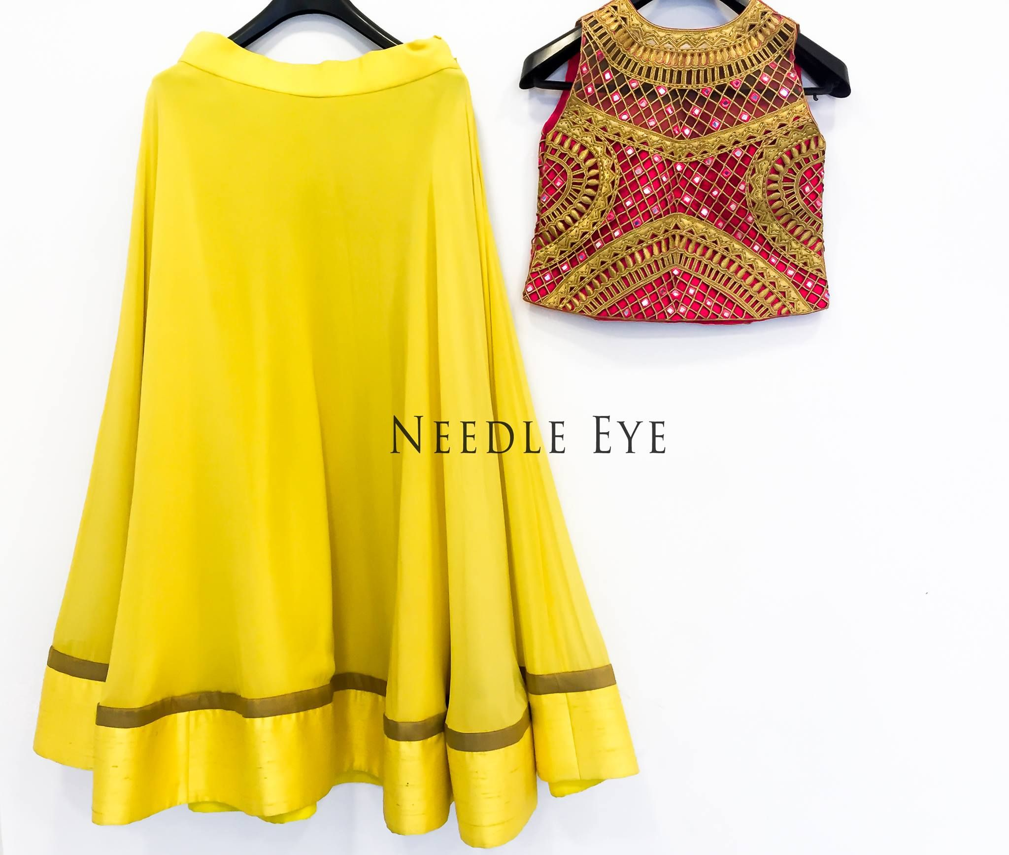 Some bright colour like this! A simple yet elegant crop top and skirt that goes well for a party.   Needleeye  bangalore  Designer In Bangalore  BridalWear.