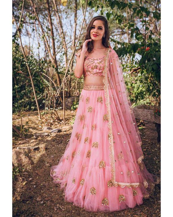 Stunning blush pink color designer lehenga and blouse with net dupatta. Lehenga and blouse with hand embroidery zardosi work.  Kamala~ Meenakshi collection of  Mrunalini Rao  .