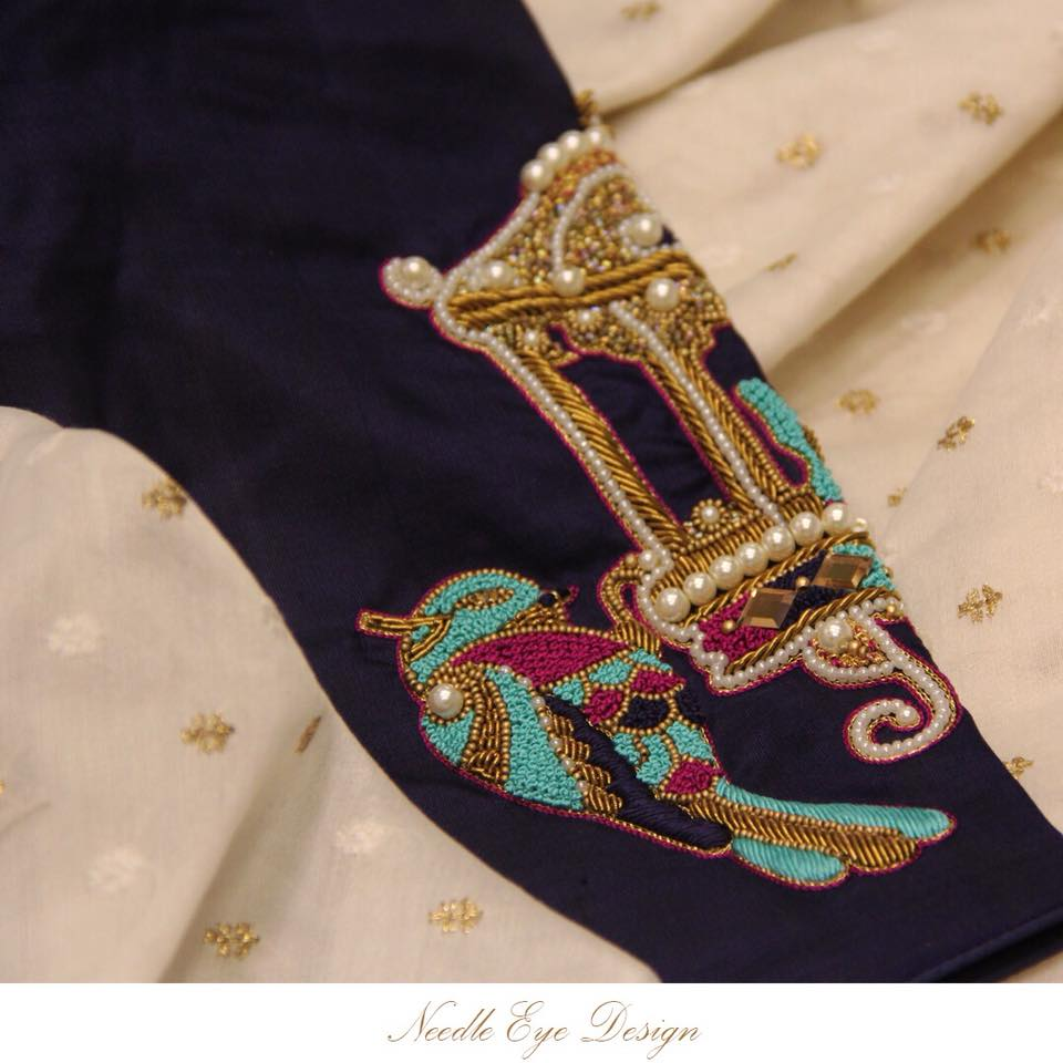 A sequence of thread and string work bird detailing beautifully embroidered on the sleeves  needleeye  needleeyeboutique