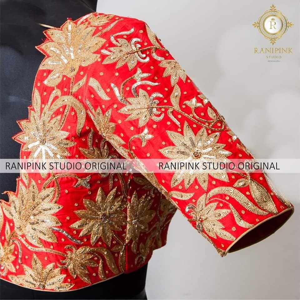Stunning red color bridal designer blouse with floral design hand embroidery gold thread and jardosi work.