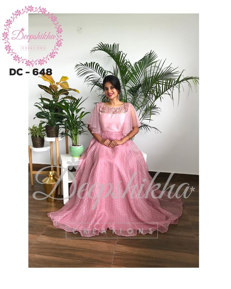 DC - 648. Stunning blush pink color floor length dress with cape. For queries kindly whatsapp: +91 9059683293.