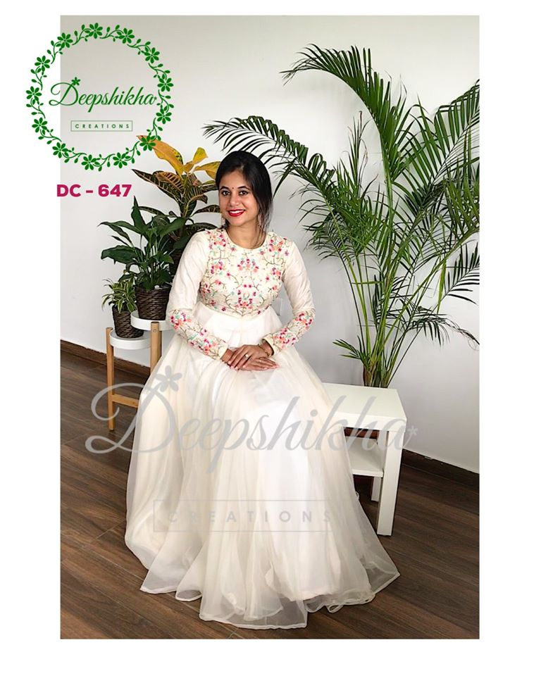 DC - 647. Stunning pearl white color floor length dress with hand embroidery work on yoke.   For queries kindly whatsapp: +91 9059683293.