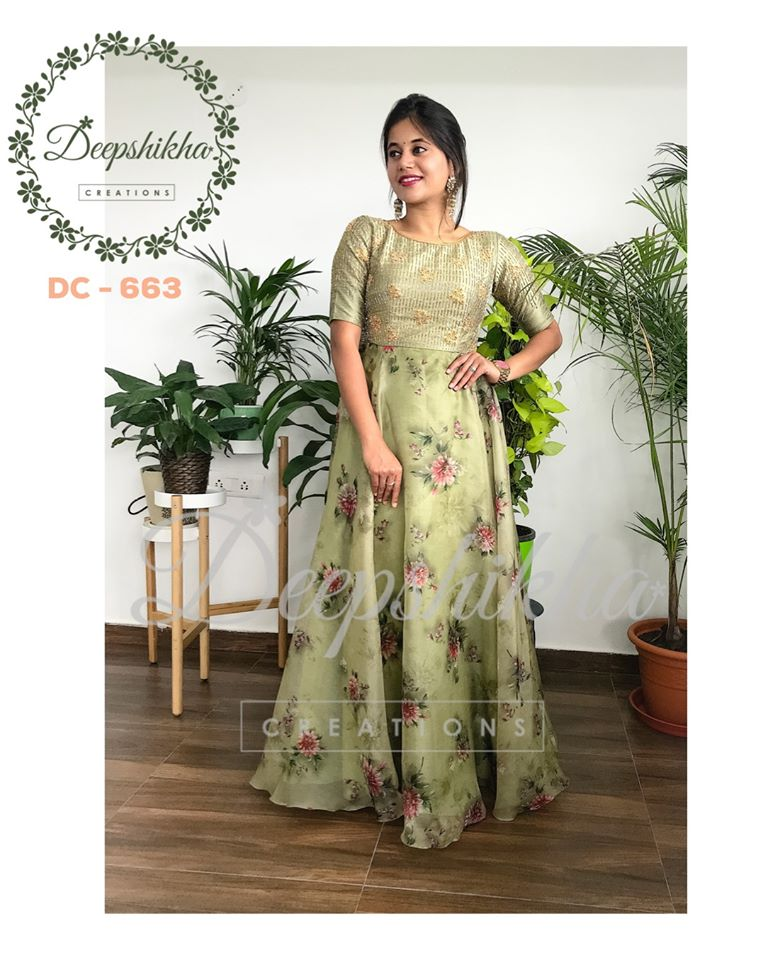 DC - 663. Stunning olive green color floor length dress with floral.  For queries kindly whatsapp: +91 9059683293