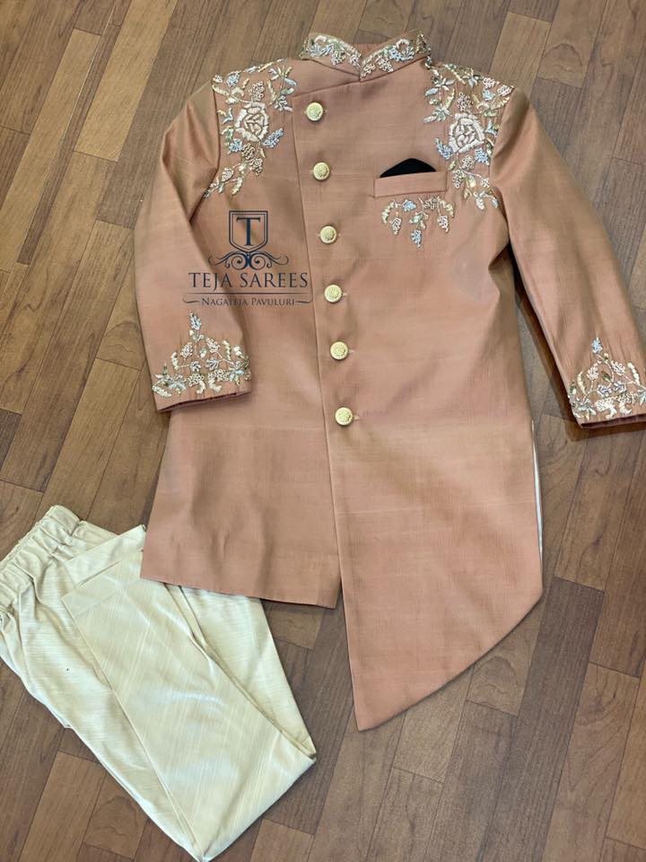 TS-MN-KDS-002 Available Customised kids outfits from Team Teja. Kids kurti with floral design hand  embroidery work.    For orders/queries Call/WhatsApp 8341382382
