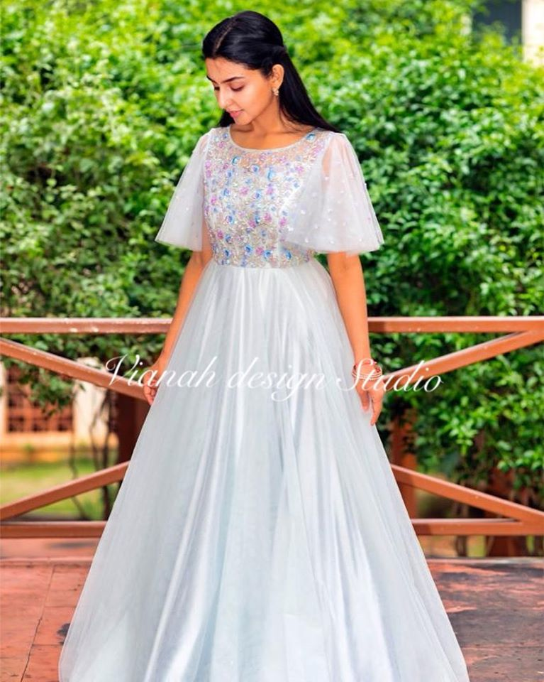 Beautiful pearl white color floor length dress with floral design hand embroidery work on yoke. Floor length dress with bell sleeves.