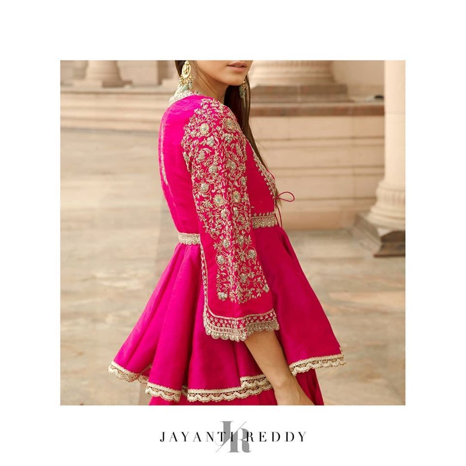 Jayanti Reddy Couture | Winter 2019. Stunning hot pink color peplum top with floral design hand embroidery work on sleeves.  Beautiful purple color designer lehenga and blouse with hand embroidery work.