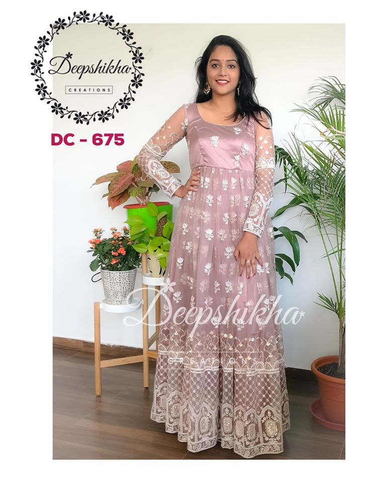 Gorgeous lavender color floor length dress with hand embroidery work all over.   DC - 675 For queries kindly whatsapp: +91 9059683293.