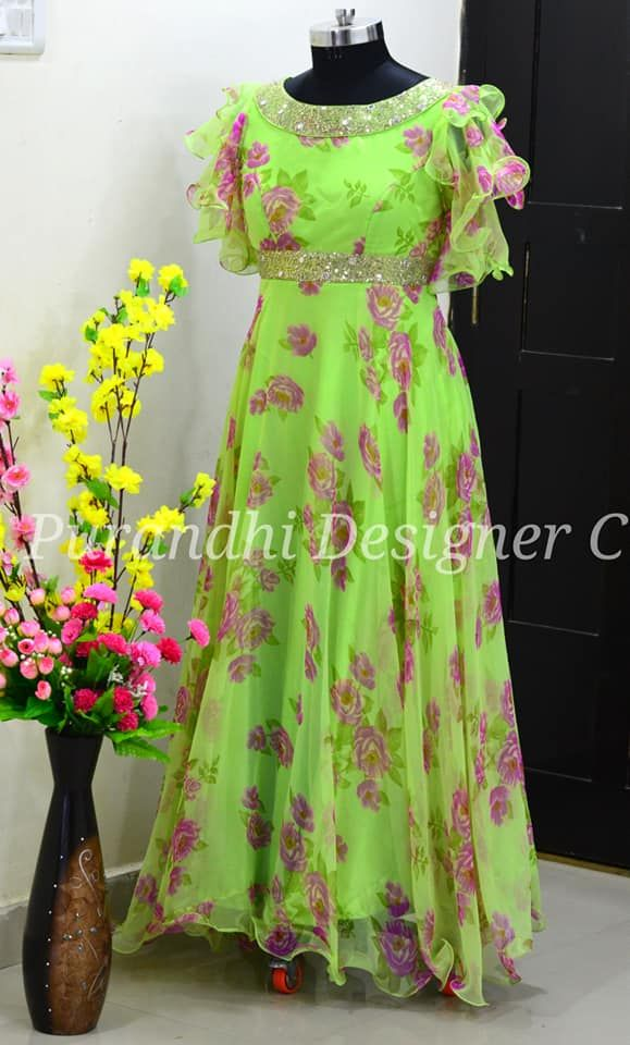 Gorgeous parrot green color floor length gown with floral print. Gown with puff sleeves.  Gown with hand embroidery stone work on neckline and waist line.