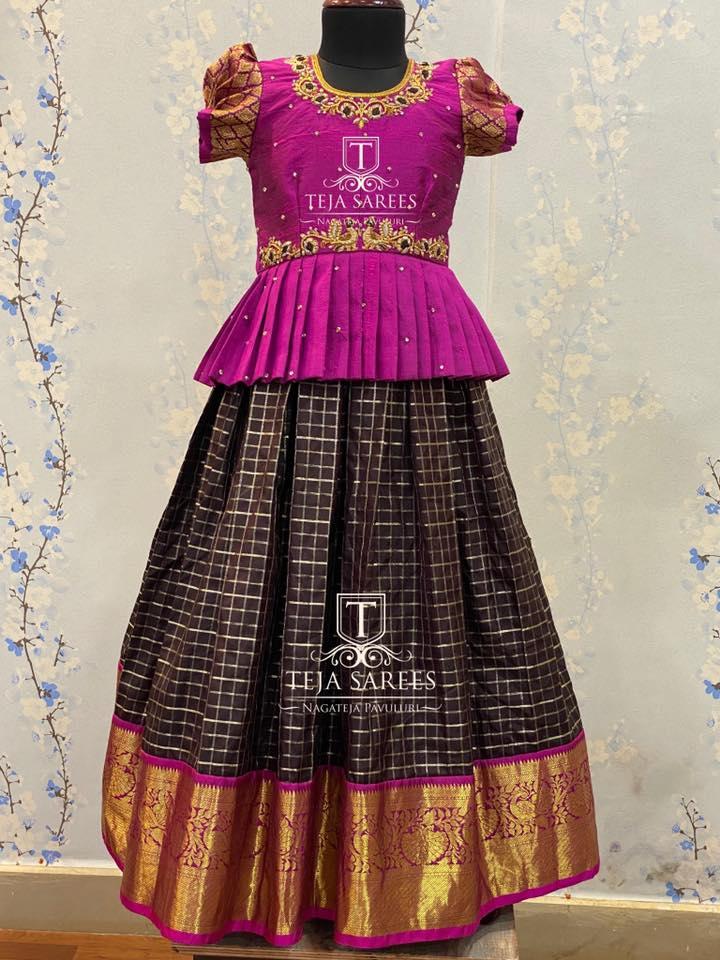 Beautiful brown color traditional kidas lehenga and purple color parikini with hand embroidery work on neckline and waist line. Parikini with butta sleeves.