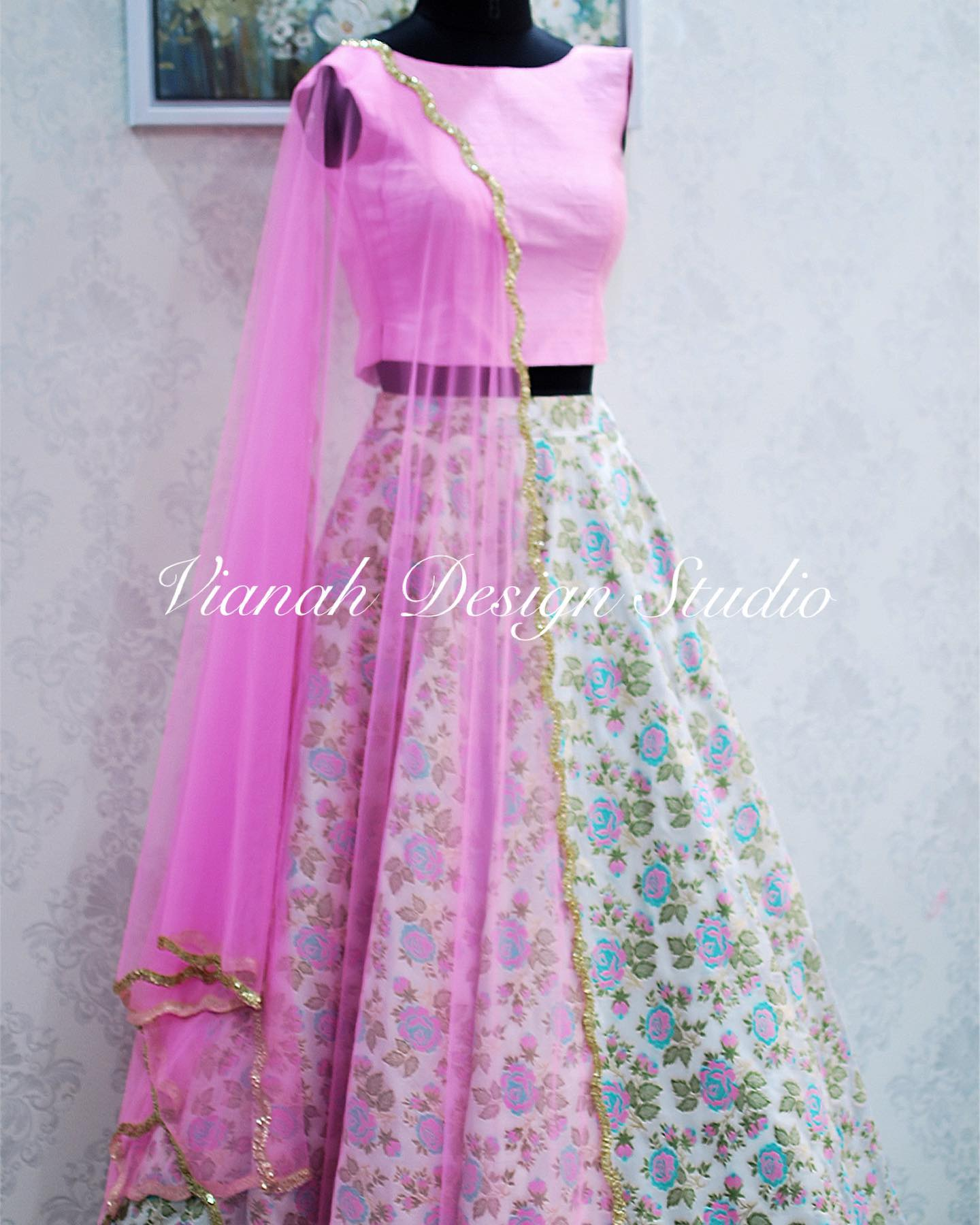 Customised Pure banaras skirt paired with pink sleeveless Crop top and cut work dupatta.