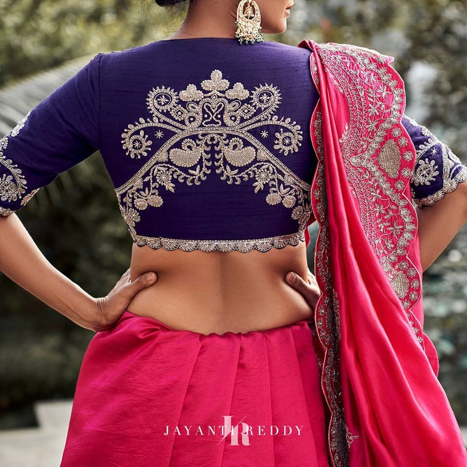 Stunning gorgeous bold pink designer saree and deep blue color designer blouse with creeper and floret lata design hand embroidery silver thread work on back of blouse.