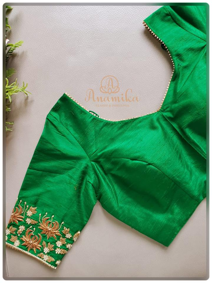 Simple green blouse with zardozi work on sleeves boarder and neckline.