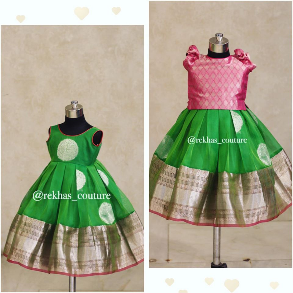 Gorgeous parrot green and pink color combination kids out fit from Rekhas house of couture.