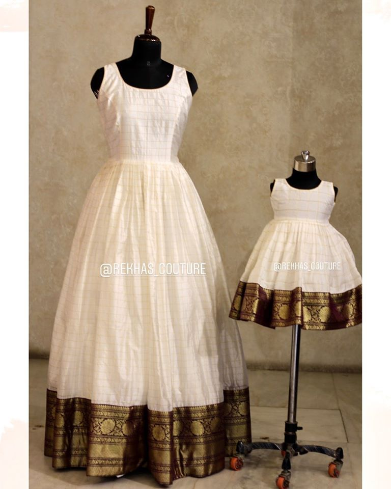 Gorgeous pearl white color pattu long frock for mom and daughter. 2020-08-04