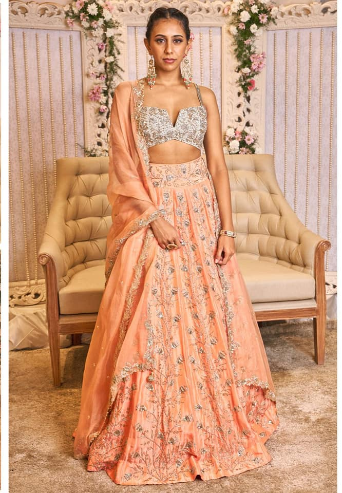 Poise  finesse and panache!   Stunning peach lehenga and bustier top with hand embroidery work. Artem enterprise. Anuasritha. Styled by br. Deeksha makeup. 2020-08-09