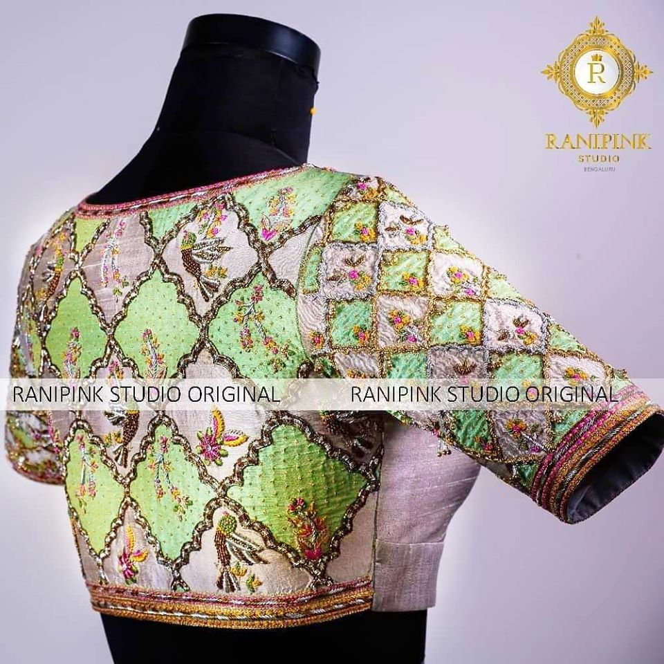 Featuring a grey and green patchwork blouse. This masterpiece from Rani pink studio. uses a very complex method of inter placed embroidered panels of each colour and accentuated with intricate dabka and zari embroidery.