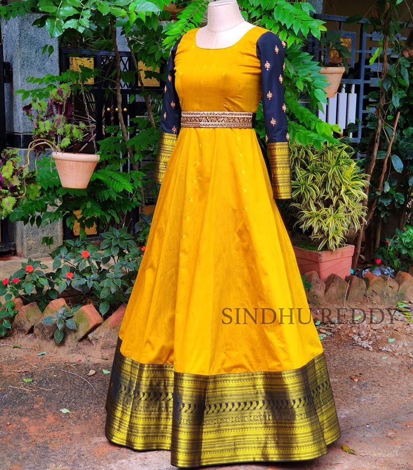 Stunning sun shine yellow color floor length pattu frock with big gold boarder. Floor length dress with waist belt. 2020-08-11