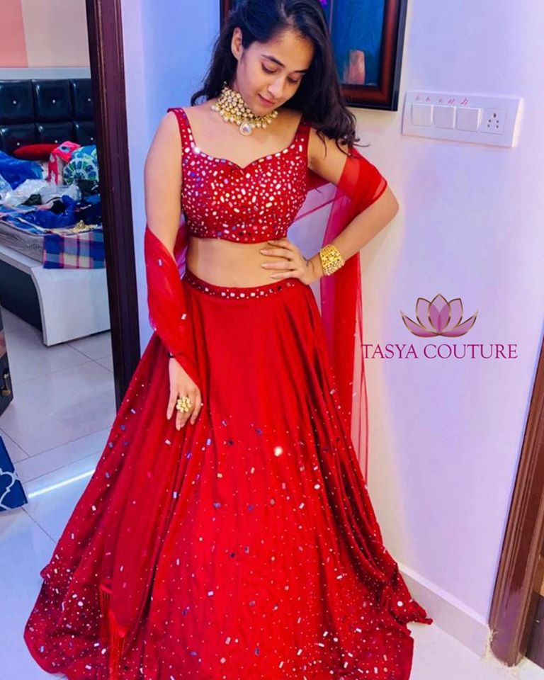 Stunning red color lehenga and blouse with net dupatta. Lehenga and blouse with hand embroidery mirror work.  2020-08-12