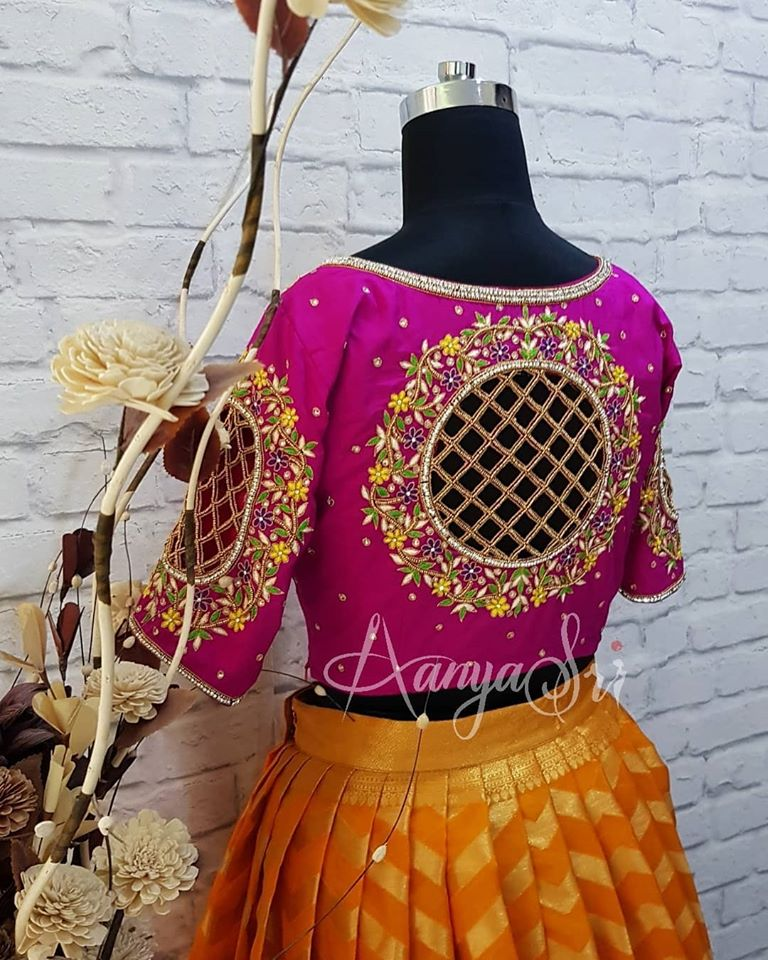 Stunning purple color designer blouse back with creeper design hand embroidery thread and cut maggam work.  2020-08-13