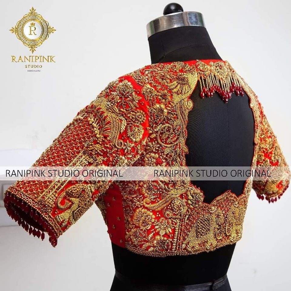 Featuring this masterpiece of a blouse from the house of Rani pink studio.. Elephants are very auspicious to South Indian weddings and this blouse is no different. Adorned with heavy zari  bead and dabka embroidery on a red base  this piece is a guaranteed standout.