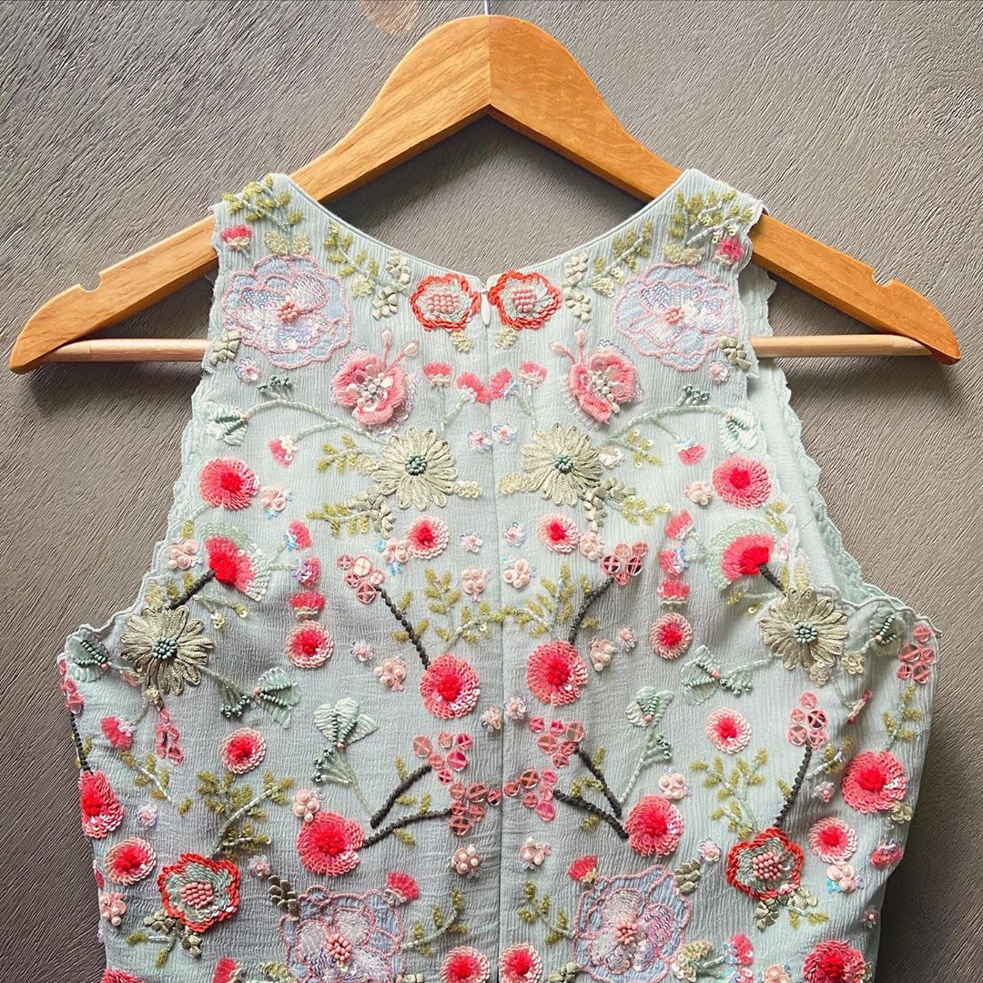 Stunning sky blue color designer top with floral design classy hand embroidery  blouse. 2020-08-22
