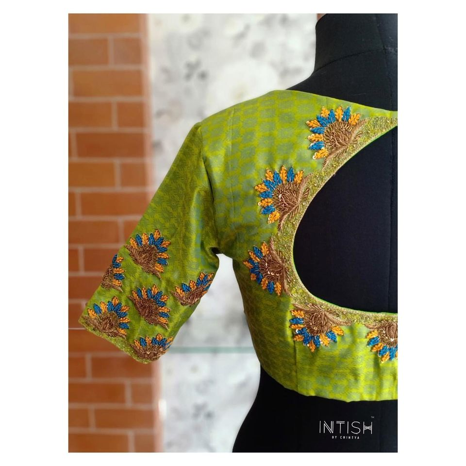 Green silk blouse with hand embroidery detailing from Intish. 2020-08-25