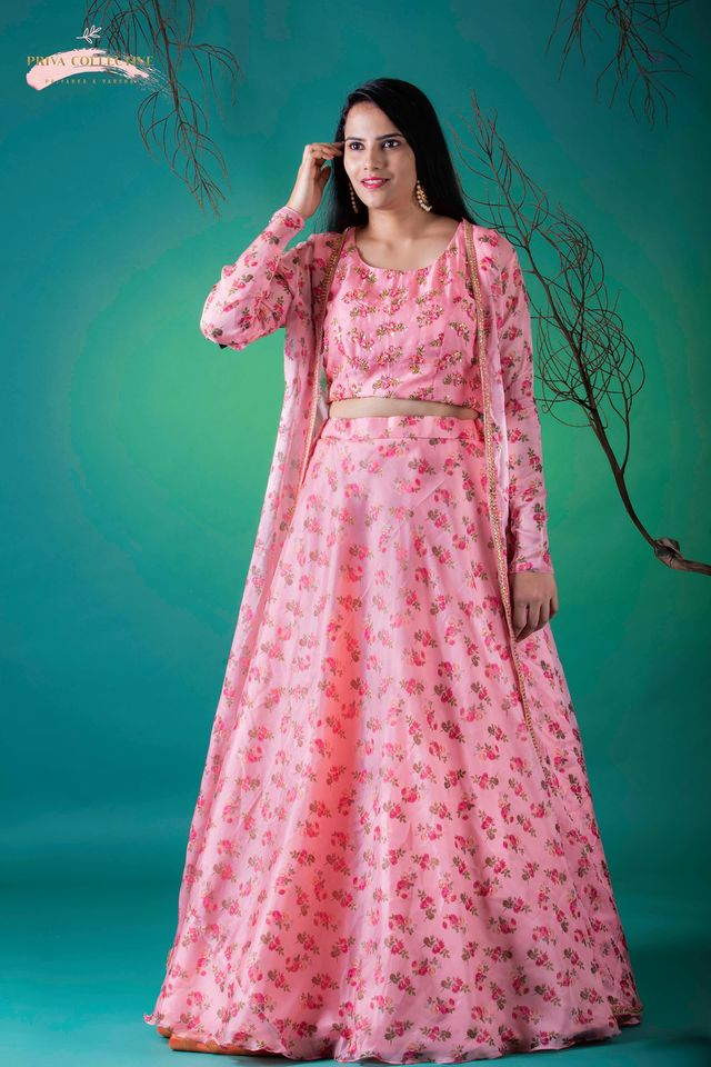 Lovely blush pink color lehenga and top with long jacket with floral print from Priva Collective.  2020-08-26