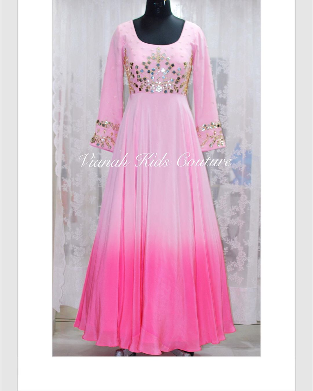 Flowy  pretty and lovely . Featuring an ombre floor length long gown in finest crepe with yoke part embellished with traditional mirror and thread work. 2020-08-27