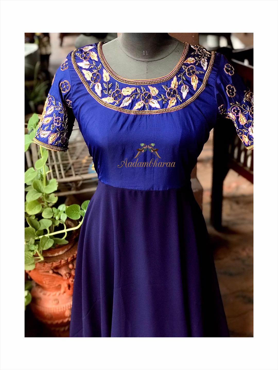 Tastefully embellished with hand embroidery  golden beads and delicate zardosi work  this royal blue indo-western outfit is a perfect ensemble for weddings and parties. Customize your Indian and Indo-west outfits with Aadambharaa today! 2020-09-05