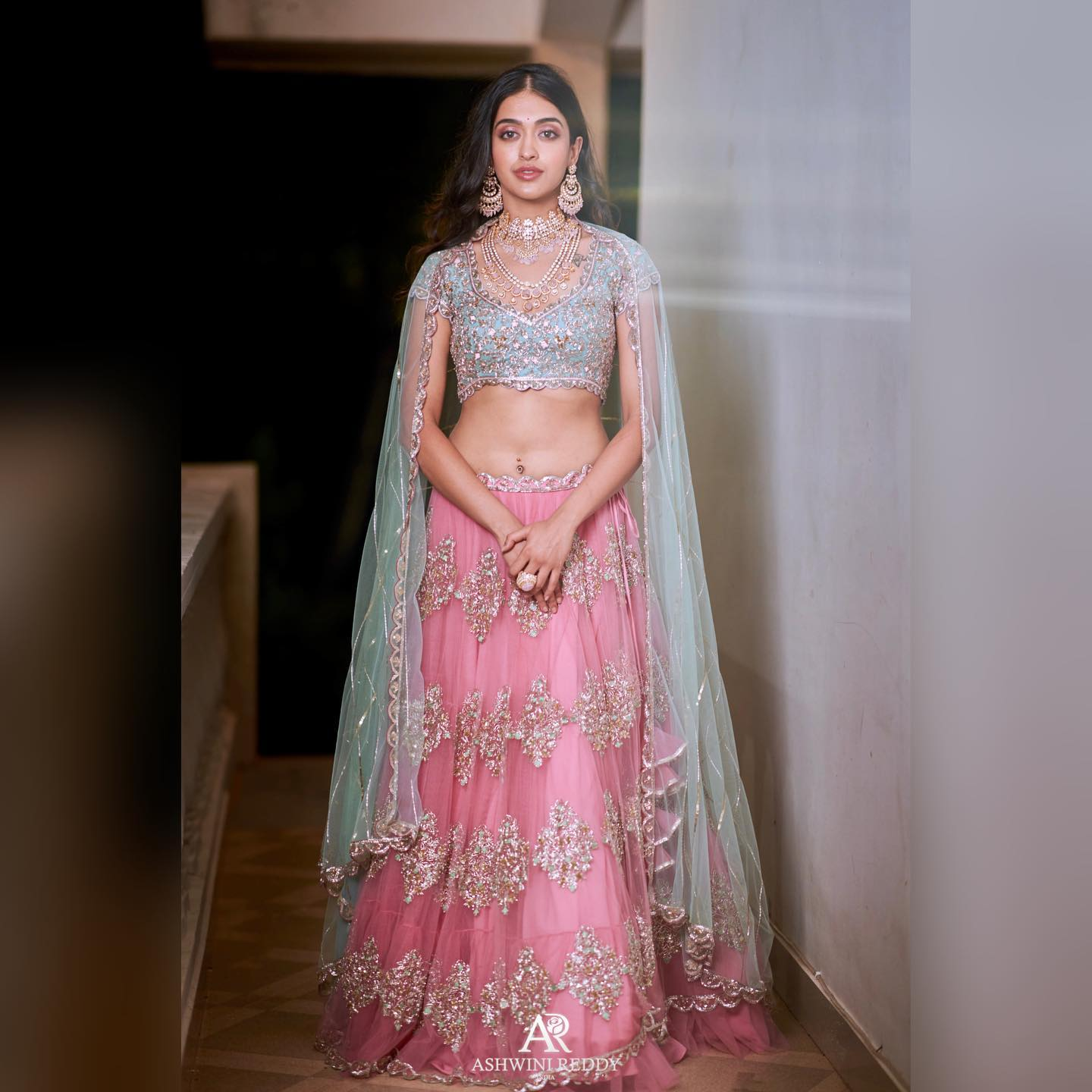 Ashwini Reddy X pmj_jewels . First from Ashwini Reddy upcoming collection! Stunning blush pink color lehenga and ice blue color blouse with long cpae sleeves. Styled by jukalker. PC Shreyansdungarwal. 2020-09-21
