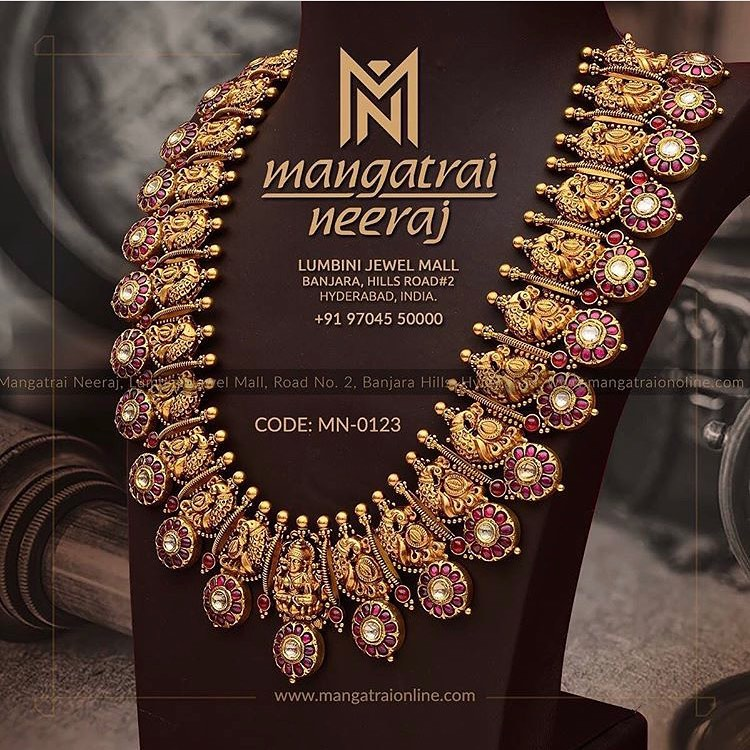 Redefining the essence of grandiosity  this majestic Bottumala by Mangatrai Neeraj portrays a deep sense of magnificence. Made with Polkis and Ruby stones  it embodies the true cultural heritage of India. |  |  |  | 2020-10-20
