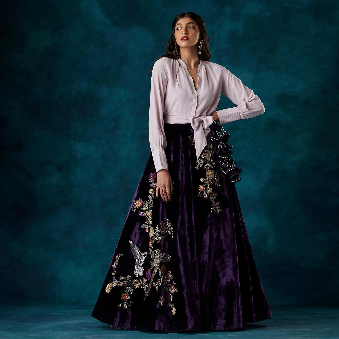 """A modern skirt lehenga in eggplant velvet paired with a crepe silk tie-up shirt. . """"BRIDAL COUTURE 20-21"""" SHYAMAL & BHUMIKA  Kindly WhatsApp us on +91-9833520520 for more information. 