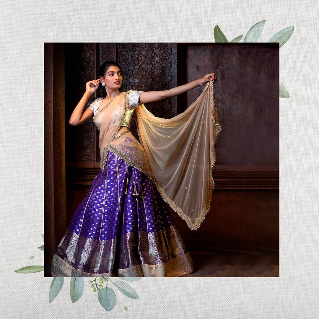 Kanchi pattu lehenga with silver zari work and all across butis and intricate architectural design on the border gives it a regal look for your special occasion.  For orders and enquiries: +91 8142029190   ruffle lehenga   new ghagra   wedding dupatta online shopping   2020-11-06