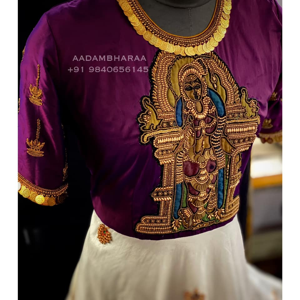 Adorn yourself with a piece of art wearing this hand embroidered Madurai meenakshi dress. The goddess on the yoke is decorated with golden beads and hand embroidery. The neck and skirt is embellished with Kemp buttas making the dress unique and one of a kind Contact  to order yours : +91 9840656145  | anarkali suits for wedding | plus size anarkali dress | ladies anarkali dress | 2020-11-22