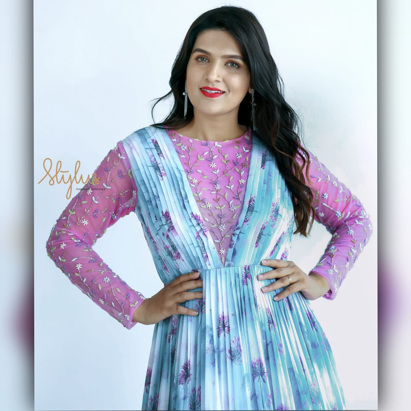 Blue is the confident purple. Blue floral layered frock with contrast pink embroidered yolk and hands. Have a party on cards? This is the right pick.   western floor touch dress   indo western dress for ladies sangeet   indo western clothing online   2020-11-23