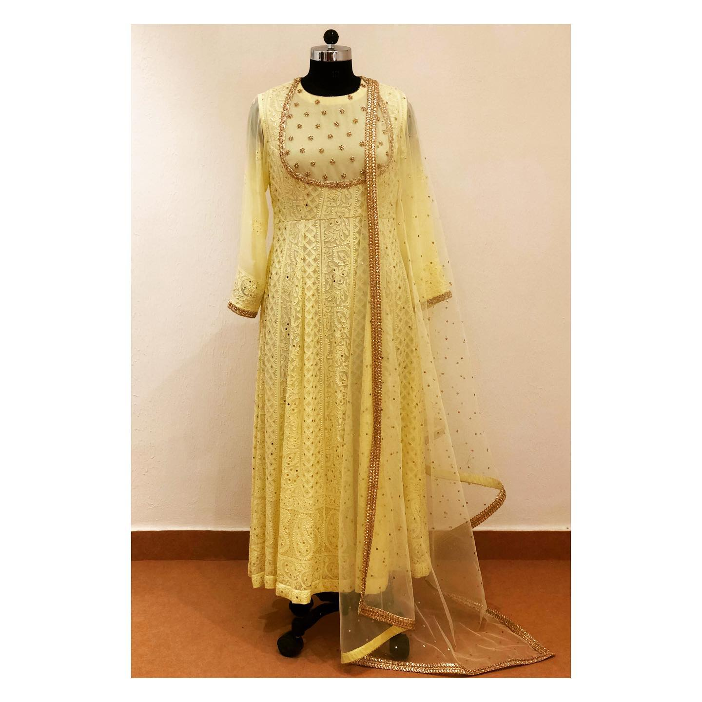 Lucknowi anarkali in pure georgette with sequins and pearl work on yoke and sleeves.