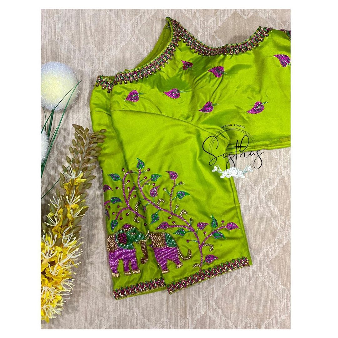In love with colors. Stunning parrot green color designer blouse with elephant hand embroidery maggam work.  | stylish blouse design | onam saree blouse designs | blouse ke gale ke design | 2020-11-26