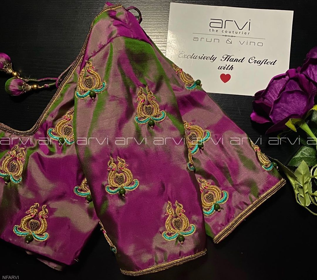 Stunning purple and green shade designer blouse with peacock motif hand embroidery bead aari work. | black blouse design | simple blouse designs for daily wear | fancy blouse design 2020 | 2020-12-03