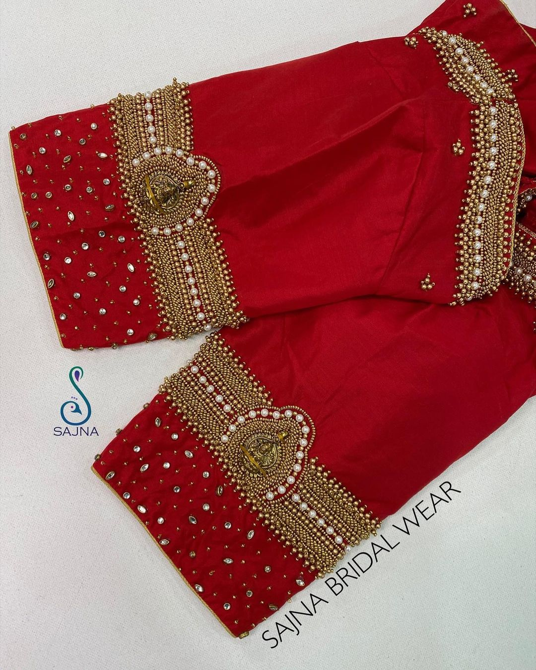 Stunning red color designer blouse with Lakshmi devi motif hand embroidery work on sleeves.  | new fashion blouse design | blouse katne ka design | velvet saree blouse | 2020-12-03