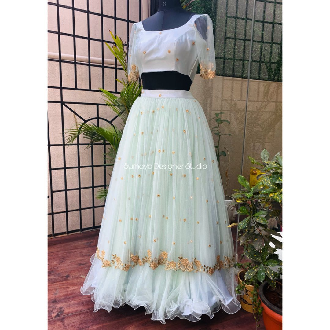 Stunning olive green color designer lehenga and blouse.   new style lehenga   lehenga with short kurti   white lehenga   2020-12-04