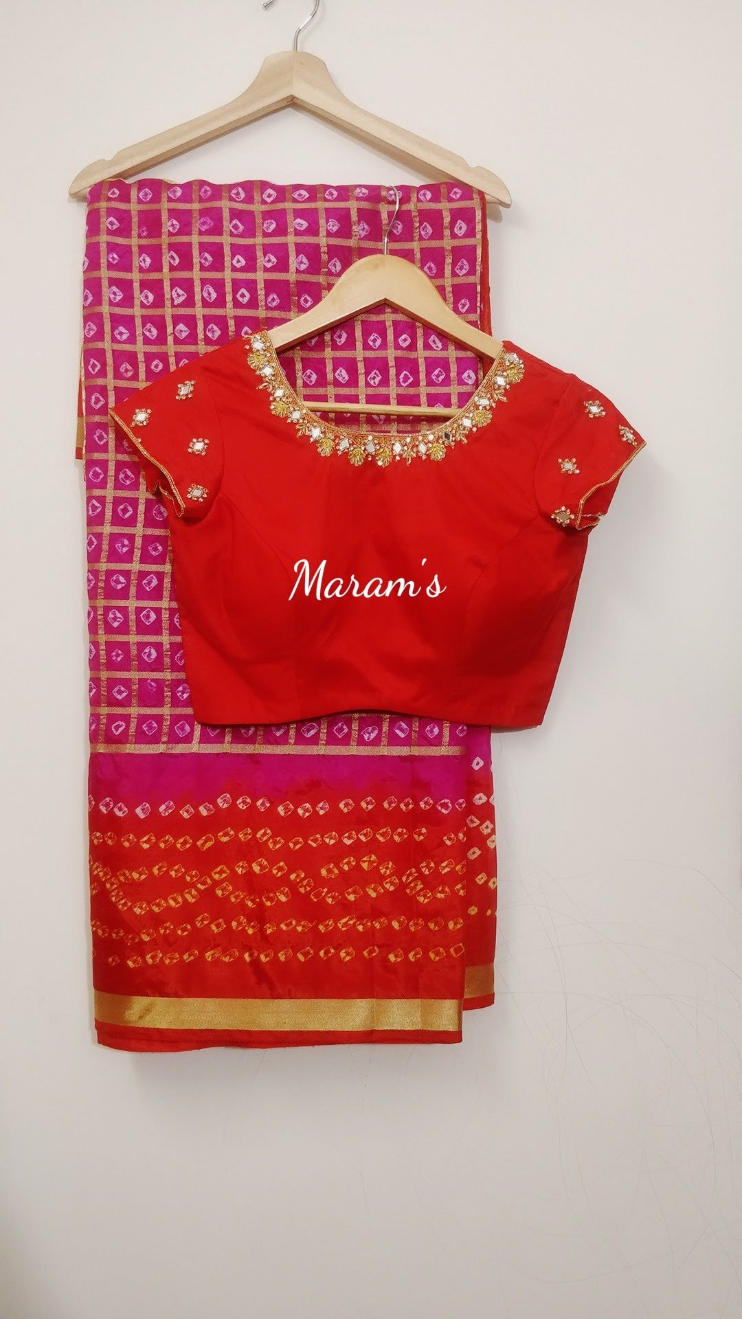 Customised hand worked blouse for the bandhini silk handpicked saree...  Pls ping us on whatsapp for more color options...  For inquires call or whatsapp on 91-9966888267 | printed saree with border | bollywood replica sarees | black saree for farewell | 2020-12-07