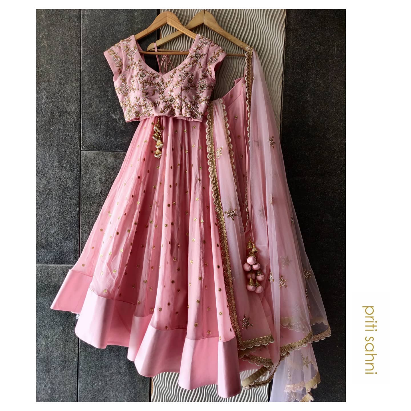 Contempory Traditional.  Rose pink embroidered lehenga set displaying unique blend of traditional and contemporary styling for modern Indian bride.  Rose pink georgette lehenga with sequin buttis all over paired with zardozi pearl hand embroidered blouse and net dupatta with scalloped zardozi and pearl with detailing  To get your dream outfit designed DM or Whatsapp on +91-9022617481  | wedding lehenga design | lacha | dulhan ghagra | 2020-12-07