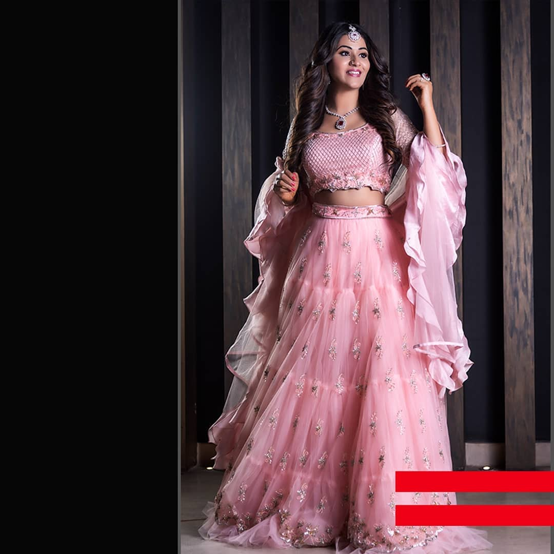 The baby pink lehenga right out of a fairy tale is all up for you this wedding season. Flaunt away the dress with the flared dupatta.   party lehenga   wedding ghagra   rajputi lehenga   2020-12-07