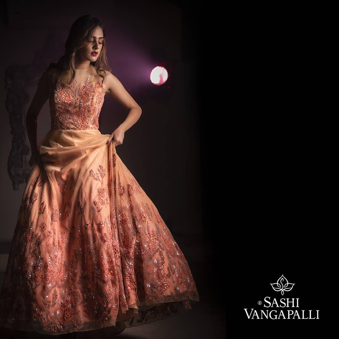 A handcrafted wedding gown with a special look from Sashi vangapalli giving you the most amazing self-loving look on a grand day with a beautiful and elaborated work of sequence thread on a net fabric.   indo western fashion dress   indo western dress for girls   indo western sharara dresses   2020-12-08