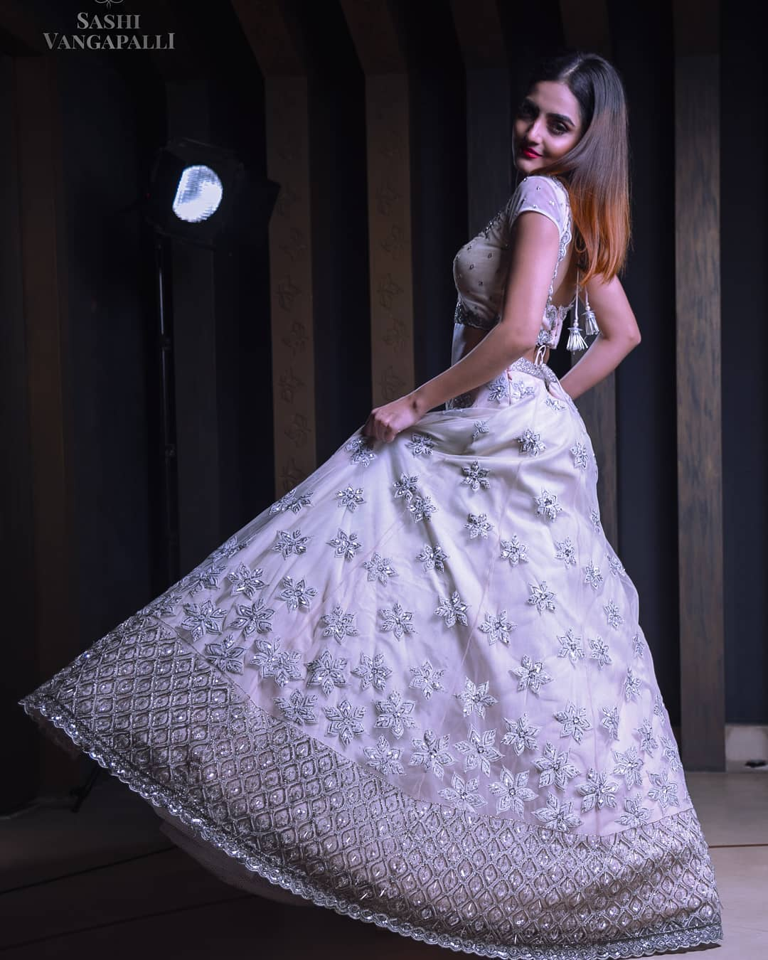 Lovely couture net lehenga with handcrafted and embellished flowers all across with a geometrical inspired intricate design all across the border is giving a beautiful look to the cocktail bride.   gujrati lehenga   banarasi lehenga   manu lehenga   2020-12-15