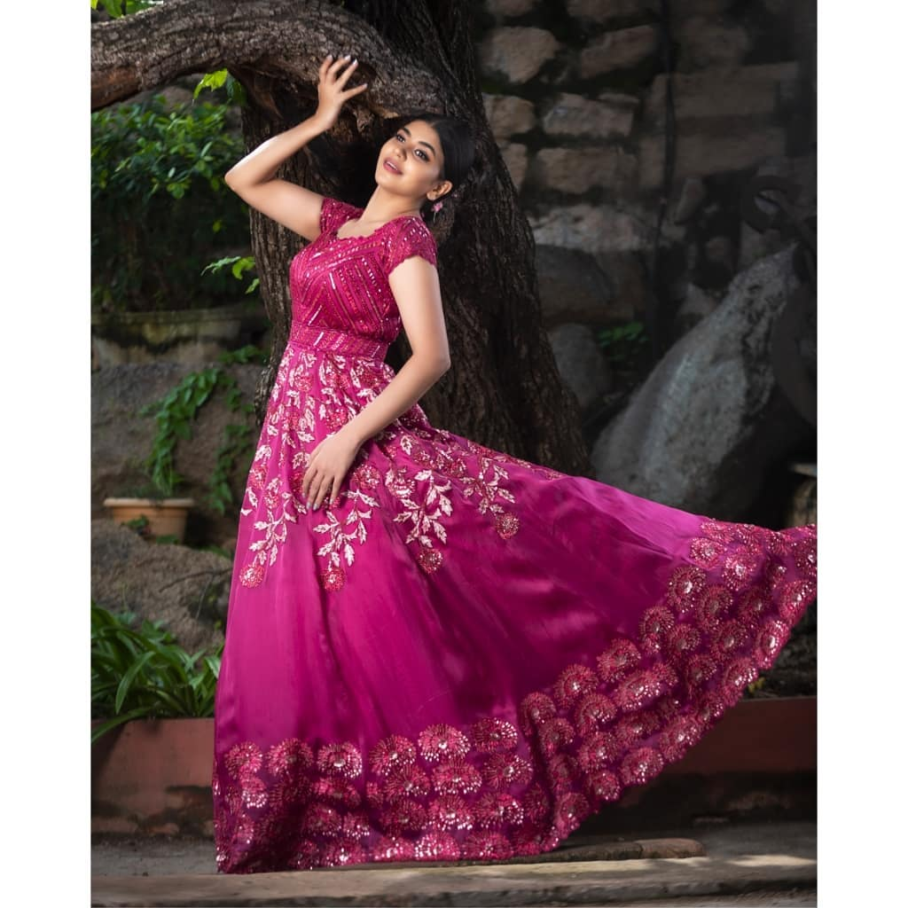 Dark pink gown with an all over sequinned work. Abstract flowers all across with edging given at the bottom.  Pink sequins and thread work is the highlight for your special occassion.   new indo western gown   latest indo western for ladies   latest trendy indo western dresses   2020-12-16