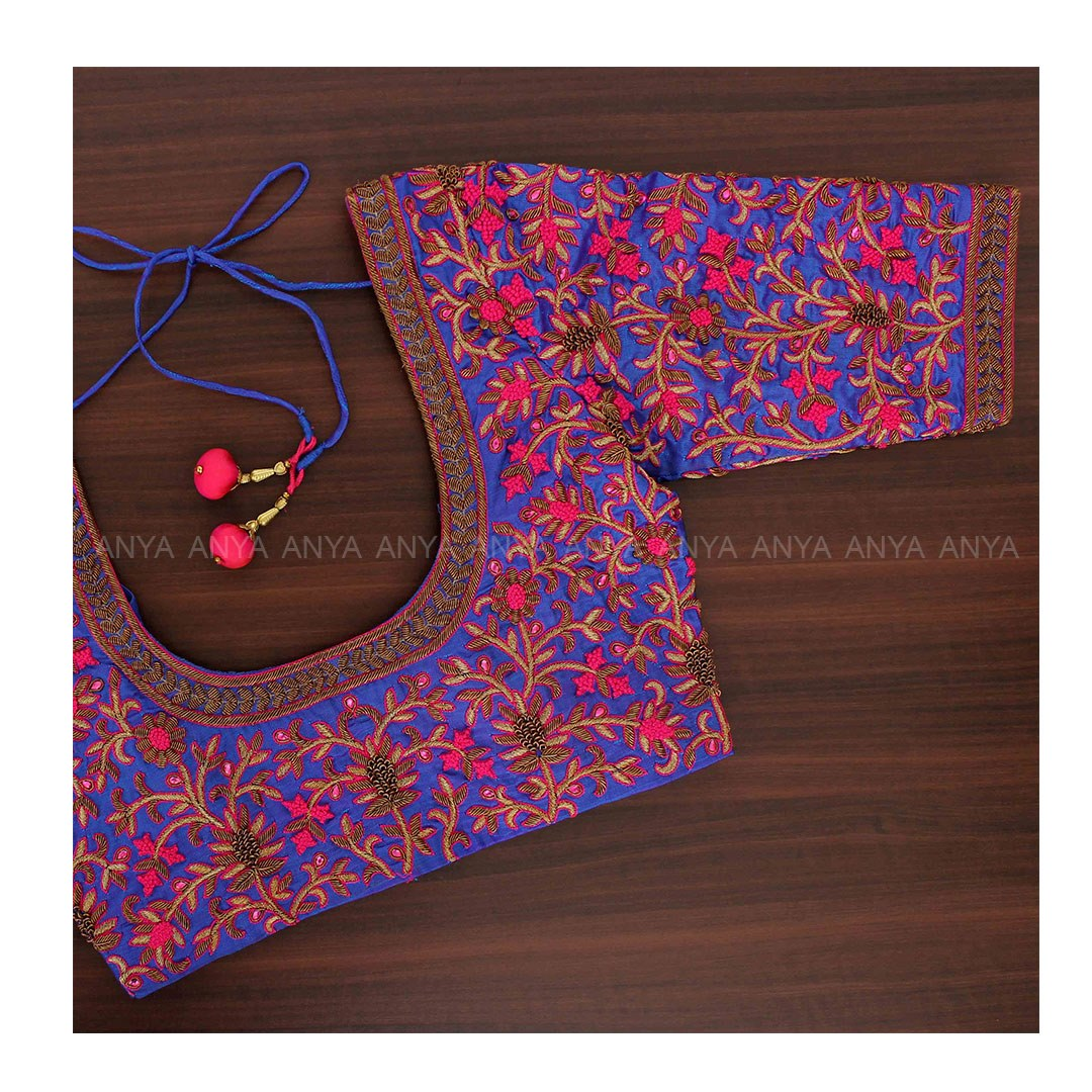 Gorgeous purple color designer blouse with floral creeper design hand embroidery thread maggam work work.    latest blouse back neck designs with borders   blouse gale ki design   maggam designs   2020-12-18