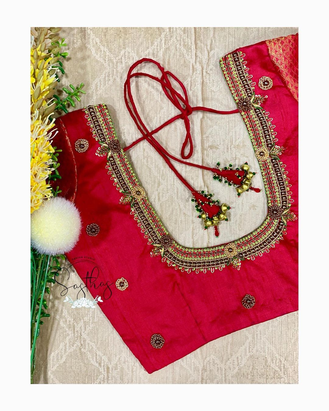 Gorgeous red color designer blouse with bead aari work on neckline and sleeves. | latest boat neck blouse designs 2020 | latest thread work blouse designs | langa blouse designs | 2020-12-18