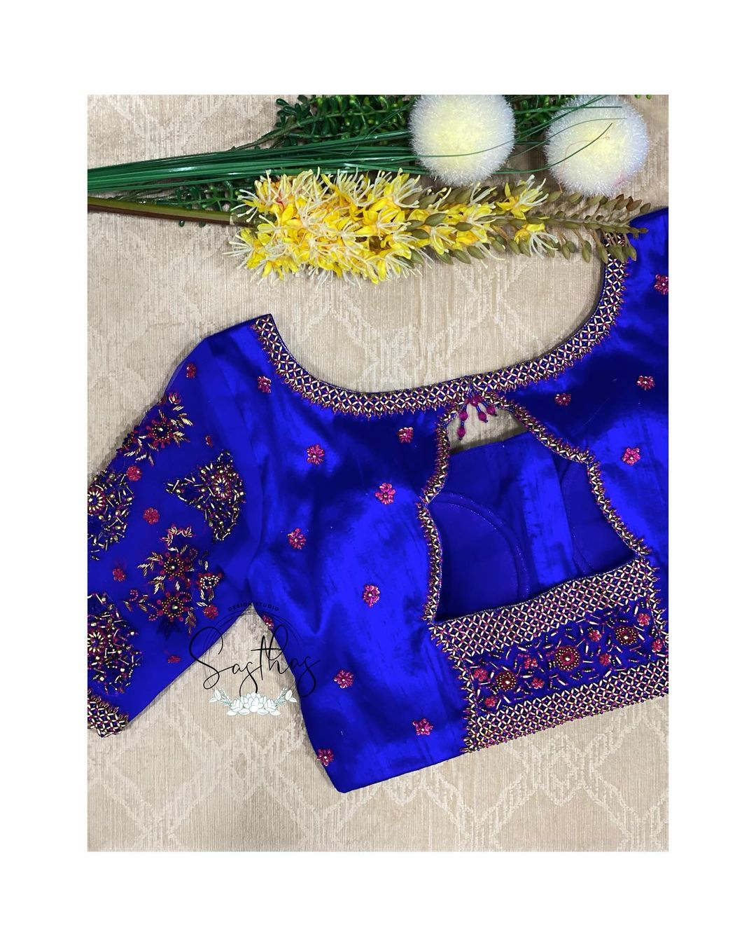 Gorgeous royal blue color designer blouse with bead aari work on neckline and sleeves. | lehenga long blouse designs | round neck blouse design | lehenga full blouse designs | 2020-12-18